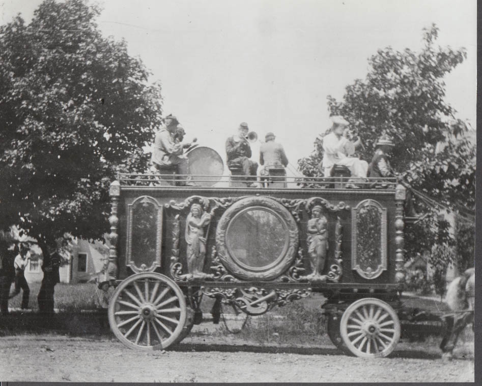Image for Circus figural-decorated wagon with band playing atop photo 1920s